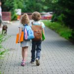 children with backpacks walking to school